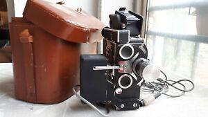 Camera Bolex Paillard Reflex  H-16mm, 3 objectifs, sacoche et accessoires