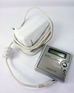 MUVO 5.0GB CREATIVE MP3 MEDIA PLAYER + charger + stuck software problem, No batt
