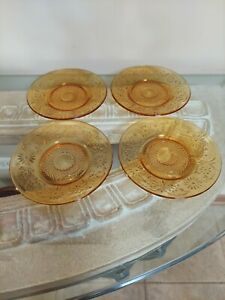 """Lot Of 4 Vintage  Amber Glass 6 """". 1 plate 3 cup plates."""