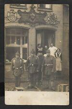 Foto-AK Glücksburg Collenburger Str. (?) Bäckerei Carl Peetz ; Soldaten um 1915