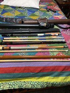 lot of 4 cue sticks