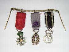 Chaînette de miniatures comprenant une médaille de la légion d'honneur, palmes