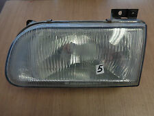 Headlight (slightly tarnished) without Actuator AIM left Kia Pride Bj.95-00