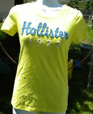 HOLLISTER CALIFORNIA SMALL YELLOW SHIRT BLUE HOLLISTER ON FRONT 1922 IN WHITE