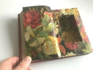 Vintage leather decoupaged book box professionally made to hide precious items.