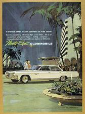 1963 Oldsmobile 98 Ninety-Eight Luxury Sedan illustration art vintage print Ad