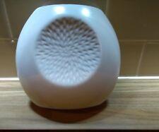 Cream ceramic egg shaped vase with dahlia petal decoration 17 x 17 cms