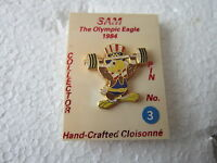 1984 LOS ANGELES   Olympics WEIGHTLIFTING  MASCOTTE Pin Badge WITH ORIGINAL CARD