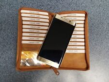GENUINE LEATHER CAMEL COLORED ZIPPERED WALLET.  CREDIT CARD, PHOTO ID, BILLFOLD.