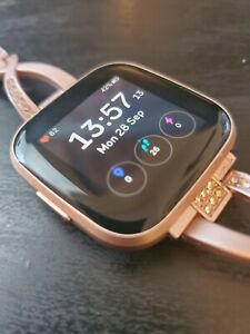 Fitbit Versa 2 Petal/Copper Rose - Includes charging cradle and 3rd party band.