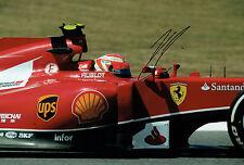 Kimi RAIKKONEN SIGNED Ferrari Formula 1 Autograph 12x8 Photo AFTAL COA