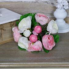 Fiori e piante finte rosi per la decorazione della casa tessuto