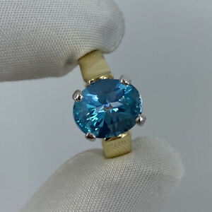 3.40 Carat Swiss Blue Topaz Oval Cut 18 Karat Yellow & White Gold Solitaire Ring