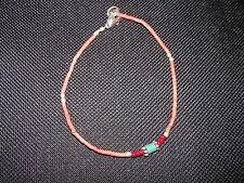 Armband mit Korall und roten Perlen und kleinem Türkisstein