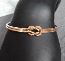 Gold Tone Love Knot Cuff Bracelet