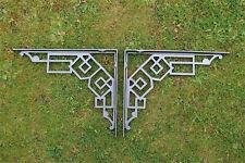A pair of large cast iron Art Deco shelf brackets geometric design bracket