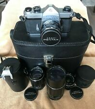 Pentax Spotmatic SP SLR with 4 Takumar lenses, cases, manuals, and 1988 receipt
