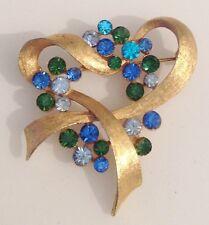 broche vintage couleur or cristaux bleu vert finement travaillé en relief 236