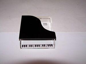Plastic piano shape note pad holder needs paper