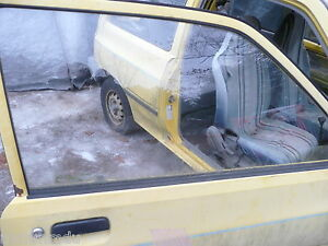 Ford Festiva Passenger's Side Front  Window