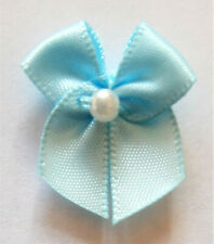 10 SMALL RIBBON BOWS  (Lt. Blue).