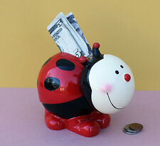 Bobble Head Ladybug Piggy Bank. Coins Money Bank