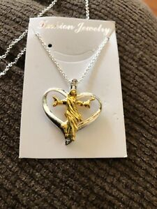 18K Yellow Gold Filled Heart With Jesus In Middle