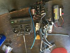 Traxxas Rc boat engine and remote with other parts ie: prop, exhaust and tiller