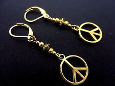 A PAIR OF  GOLD TONE DANGLY   PEACE SIGN LEVERBACK HOOK EARRINGS. NEW.
