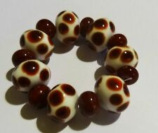 7 WHITE WITH RED SPOTS LAMPWORK BEADS WITH SPACERS BEADS