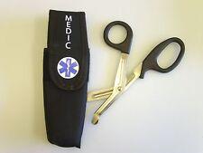 Staff of lifep aramedic Tuff cut scissors and padded belt pouch