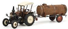 SCH7699 - Tracteur LANZ BULLDOG couleur marron avec cabine et une remorque citer