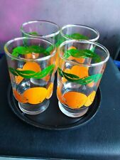 Vintage juice glasses with oranges