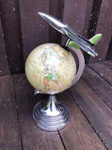 Decorative World Globe Surmounted With A 1960's Chrome Jet Fighter Plane