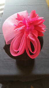 Fascinator -Pink sinamay with flower and feathers mounted on a clip