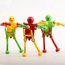 New Dancing Clockwork Spring Wind Up Robot Random color Toy For Children Kids