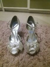 MK one Silver bow shoes size 6