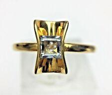 Tension Set Emerald Cut Aquamarine 18K Yellow Gold Ring