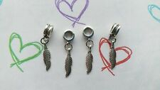 4 Tibetan Silver Feather charms With Bail Beads