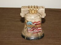 "VINTAGE 4 1/2"" HIGH UNITED STATES FLAG CANNON LIBERTY BELL  PLASTIC COIN BANK"