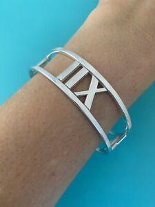 Tiffany & Co Narrow Cutout Pierced WIDE Atlas Roman Numeral Bangle Bracelet.