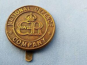 The National Defence Company cap badge.5.
