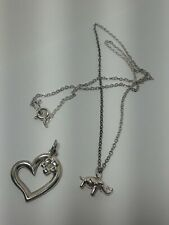 Silver Colored Chain with Tiny Silver Elephant and Heart Shaped Floral Pendant