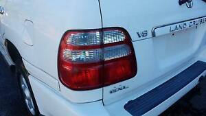 TOYOTA LANDCRUISER LEFT TAILLIGHT 100 SERIES, 10/02-06/05 GENUINE WITH A FEW VER