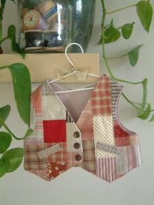 A handmade patchwork waistcoat for a teddy bear.