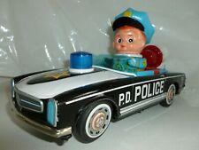 POLICE CAR P.D. BOY FIGURE SIREN MOTOR BATTERY TIN TOY TRADE MARK VINTAGE JAPAN