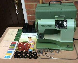 Vintage Elna Supermatic Sewing Machine with accessories and manuals