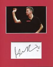 A 10 x 8 inch mount personally signed by Darts Player Magnus Caris.