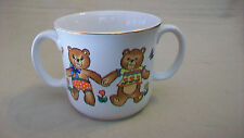 CHILDREN'S CERAMIC TWO HANDLE DRINKING CUP WITH TEDDY BEAR DESIGN