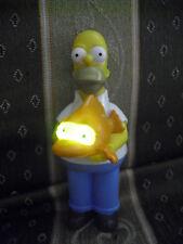 Pupazzo Homer Simpson con pesce mutante con occhi luminosi (di plastica 14 cm)